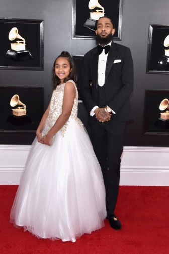 LOS ANGELES, CA - FEBRUARY 10: Nipsey Hussle (R) and guest attend the 61st Annual GRAMMY Awards at Staples Center on February 10, 2019 in Los Angeles, California. (Photo by John Shearer/Getty Images for The Recording Academy)